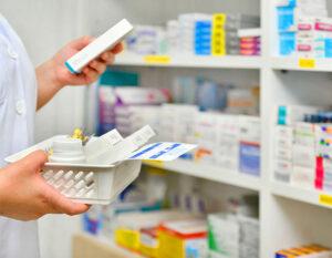 pharmacist filling prescription pharmacy drugstore