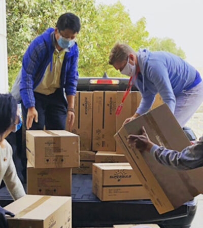 group of people shipping the parcel